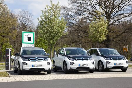 i3: Frankfurt, Germany - March 30, 2017: Three BMW i3 electric vehicles at a charging station