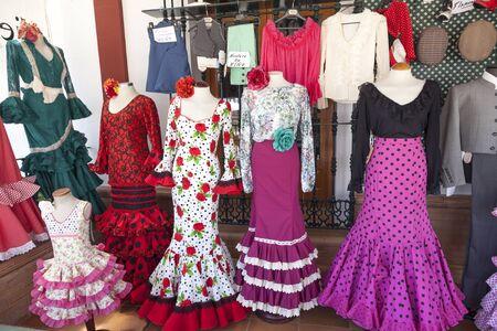 El Rocio, Spain - June 2, 2017: Traditional spanish flamenco dresses for sale in El Rocio during the Romeria 2017. Province of Huelva, Almonte, Andalusia, Spain