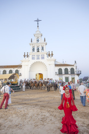 El Rocio, Spain - June 1, 2017: Piilgrims in traditional spanish dress in front of the hermitage in El Rocio during the Romeria 2017. Andalusia, Spain Editorial