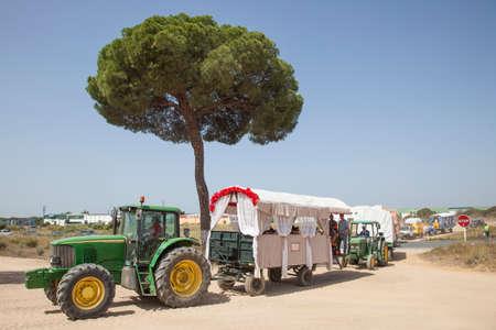 camino: El Rocio, Spain - June 2, 2017: Pilgrims with tractor trailers on the road to El Rocio during the pilgrimage Romeria 2017. Province of Huelva, Andalusia, Spain Editorial
