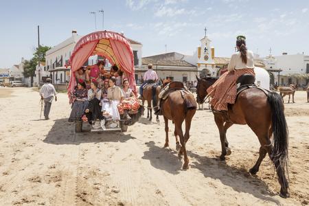 El Rocio, Spain - June 2, 2017: Pilgrims with a donkey cart in El Rocio during the Romeria 2017. Province of Huelva, Almonte, Andalusia, Spain Editorial