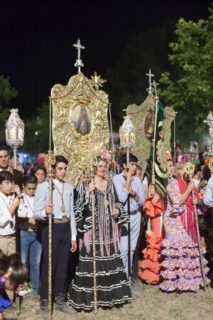 El Rocio, Spain - June 4, 2017: Procession of piilgrims in traditional spanish dress in El Rocio during the Romeria 2017. Andalusia, Spain Editorial