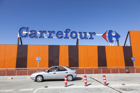 Huelva, Spain - June 3, 2017: Subsidiary of the french supermarket chain Carrefour in the city of Huelva, Andalusia, Spain