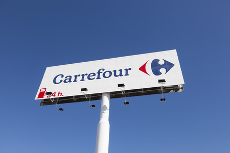 Huelva, Spain - June 3, 2017: Logo of the french supermarket chain Carrefour in the city of Huelva, Andalusia, Spain Editorial