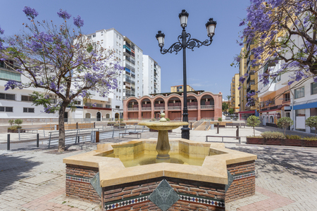 Market square with fountain in the city of San Pedro de Alcantara. Malaga Province, Andalusia, Spain Stock Photo