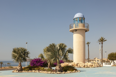 Lighthouse replica in a roundabout in Puerto de Mazarron, Province of Murcia, southern Spain Stock Photo