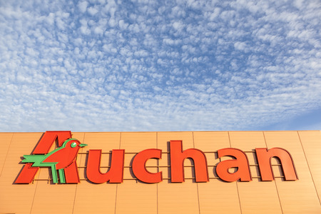 headquartered: Paris, France - June 9, 2017: Logo of the french international supermarket chain Auchan. The corporation is headquartered in Croix, France