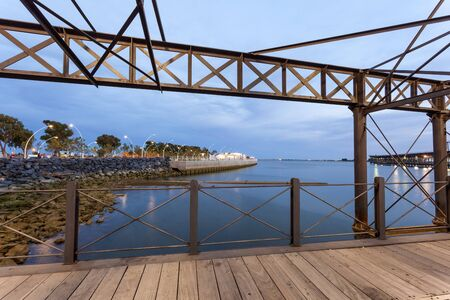 Old ironwork quay - Muelle del Tinto - at the river Rio Tinto in the city of Huelva. Andalusia, Spain Stock Photo