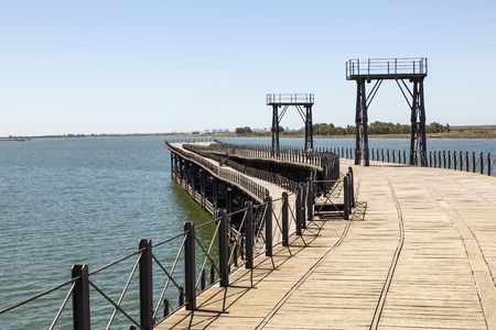Old ironwork quay - Muelle del Tinto - at the river Rio Tinto in the city of Huelva. Andalusia, Spain Editorial