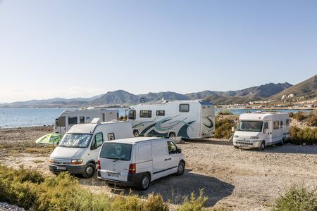 Azohia, Spain - May 14, 2017: Luxury mobile homes parked at the mediterranean coast in town La Azohia. Province of Murcia, Spain