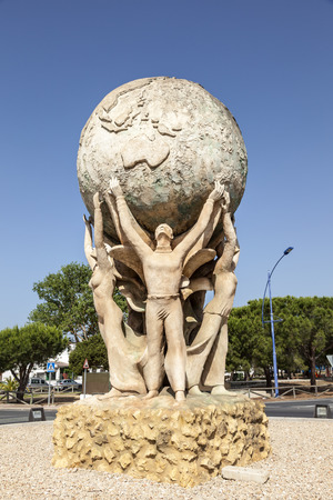 Matalascanas, Spain - June 2, 2017: Sculpture of an unknown artist in the spanish town Matalascanas. Huelva Province, Andalusia, Spain Editorial