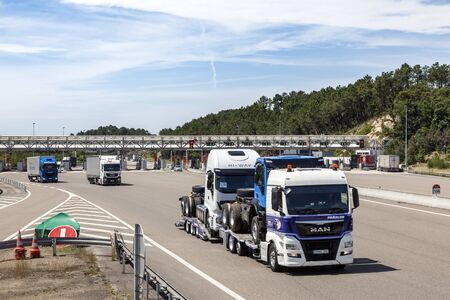 Bordeaux, France - June 8, 2017: Trucks at the toll gate station on the highway in France