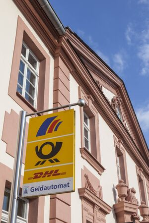 Weilburg, Germany - Sep 3, 2017: Postbank and DHL service sign on the historic building in Weilburg, Germany