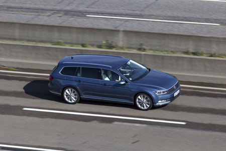 Frankfurt, Germany - Sep 19, 2017: Large family car Volkswagen Passat Variant driving on the highway in Germany