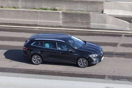 Frankfurt, Germany - Sep 19, 2017: Black Renault Megane GrandTour driving on the highway in Germany
