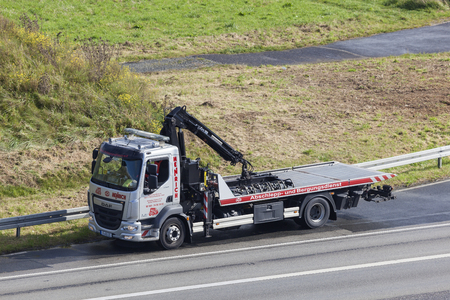Frankfurt, Germany - Sep 19, 2017: DAF LF tow and wrecking truck on the highway in Germany