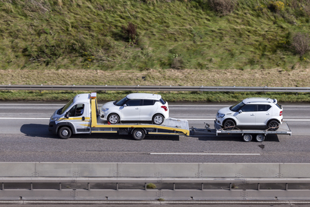 Frankfurt, Germany - Sep 19, 2017: Fiat Ducato car transporter with a trailer loaded with new Suzuki cars on the highway