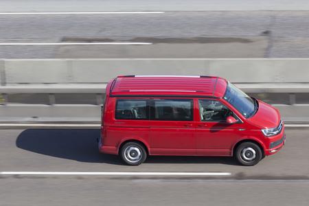 Frankfurt, Germany - Sep 19, 2017: Red Volkswagen T5 Minivan driving on the highway in Germany Editorial