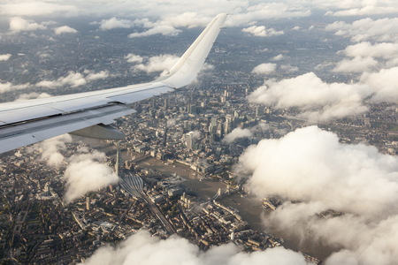 Aerial view of London city and the River Thames from an airplane window