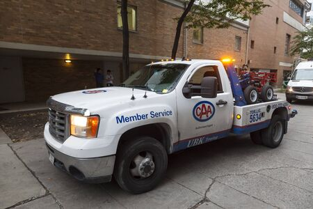 Toronto, Canada - Oct 11, 2017: CAA Roadside Assistance service truck downtown in Toronto. Province of Ontario, Canada Editorial