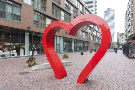 Toronto, Canada - Oct 13, 2017: Red hearth at the historic distillery district in Toronto. Province of Ontario, Canada