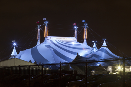 Toronto, Canada - Oct 13, 2017: Cirque du Soleil circus tent big top illuminated at night. Toronto, Province of Ontario, Canada