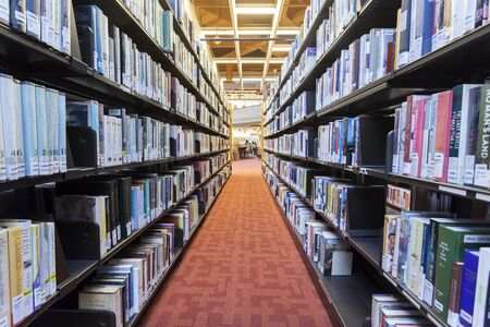 Toronto, Canada - Oct 12, 2017: Bookshelves at the Toronto Reference Library. This library is one of the three largest libraries in the world. Province of Ontario, Canada