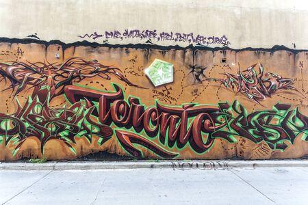 Toronto, Canada - Oct 12, 2017: Colorful graffiti in the graffiti alley in the city of Toronto. Province of Ontario, Canada