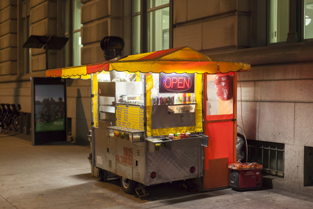 Toronto, Canada - Oct 16, 2017: Hot Dog stand in the city of Toronto illuminated at night. Editorial