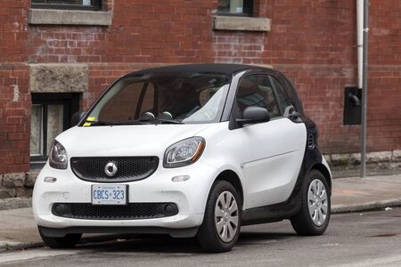 Toronto, Canada - Oct 14, 2017: Smart Fortwo city car parked in a street of Toronto downtown Editorial