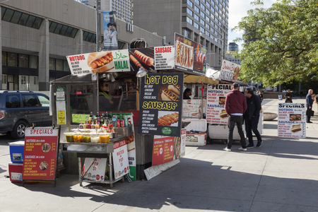 Toronto, Canada - Oct 16, 2017: People at a Hot Dog stand in the city of Toronto