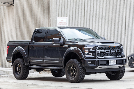 Toronto, Canada - Oct 14, 2017: Black Ford F 150 SVT Raptor Dakar Edition on a parking lot in the city of Toronto 에디토리얼