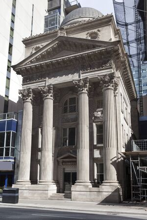 Facade of a classic building with columns in the city of Toronto, Canada