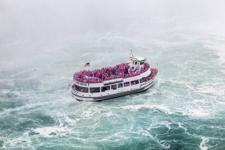 Niagara Falls, Canada - Oct 15, 2017: The Maid of the Mist boat with tourists during a tour to the Horseshoe Falls