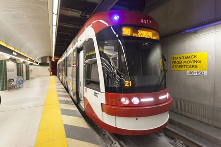 Toronto, Canada - Oct 17, 2017: Modern streetcar at a underground station Spadina in the city of Toronto. Province of Ontario, Canada