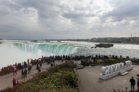 Niagara Falls, Canada - Oct 15, 2017: Tourists at the viewing platform at the Niagara Falls. Province of Ontario, Canada Editorial