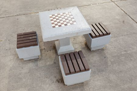 Chess table in a city park Banco de Imagens