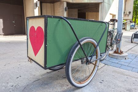 Bike with a trailer parked downtown in the city  Banco de Imagens