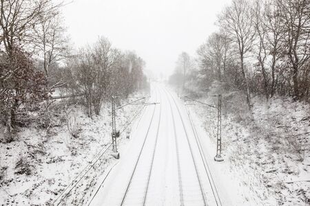 Snow covered railroad track during a blizzard in winter Banco de Imagens - 92414736