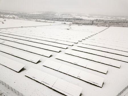Snow covered solar power plant in winter Banco de Imagens - 92020301