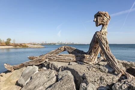 Toronto, Canada - Oct 19, 2017: Large driftwood sculpture by Julie Ryan and Thelia Sanders-Sheltonat at the Humber Bay Shores Park inToronto, Canada