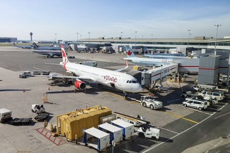 Toronto, Canada - Oct 22, 2017: Air Canada and rouge airplanes at the Toronto Pearson International Airport, Canada Banco de Imagens - 132499159