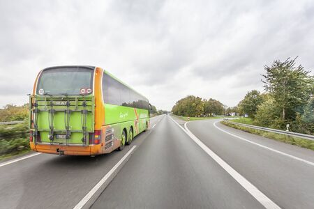 Unna, Germany - Oct 28, 2017: Green Flixbus Meinfernbus european long distance coach on the highway in Germany Banco de Imagens - 132499160