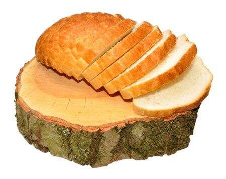 bloomer: A crusty white sliced bloomer bread loaf on a tree stump, isolated on a white background Stock Photo