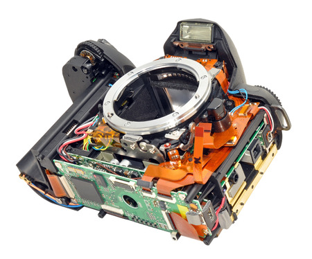 dismantled: A faulty digital single reflex camera dismantled for repair Stock Photo