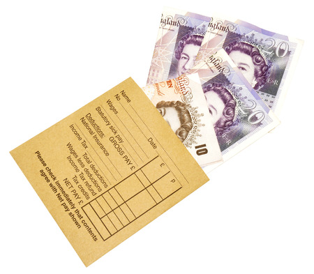 A brown manila salary envelope with English ten and twenty pound bank notes, isolated on a white background