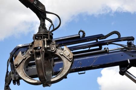 Scrap yard hydraulic Claw Crane with a sky background photo