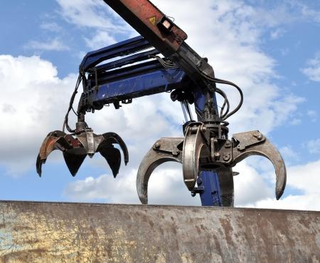 grabber: Scrap yard hydraulic Claw Crane with a sky background
