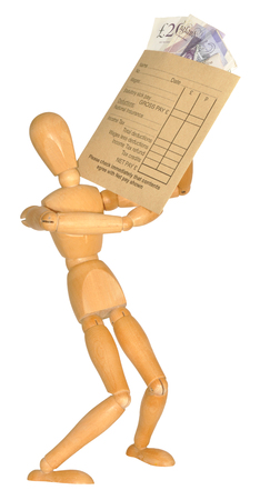 A wooden mannequin carrying a wage packet envelope with banknotes, isolated on a white background photo