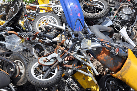 seized: Pile of scrapped motorcycles seized by the police waiting to be crushed  Editorial